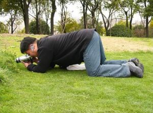 Man photgraphing the ground